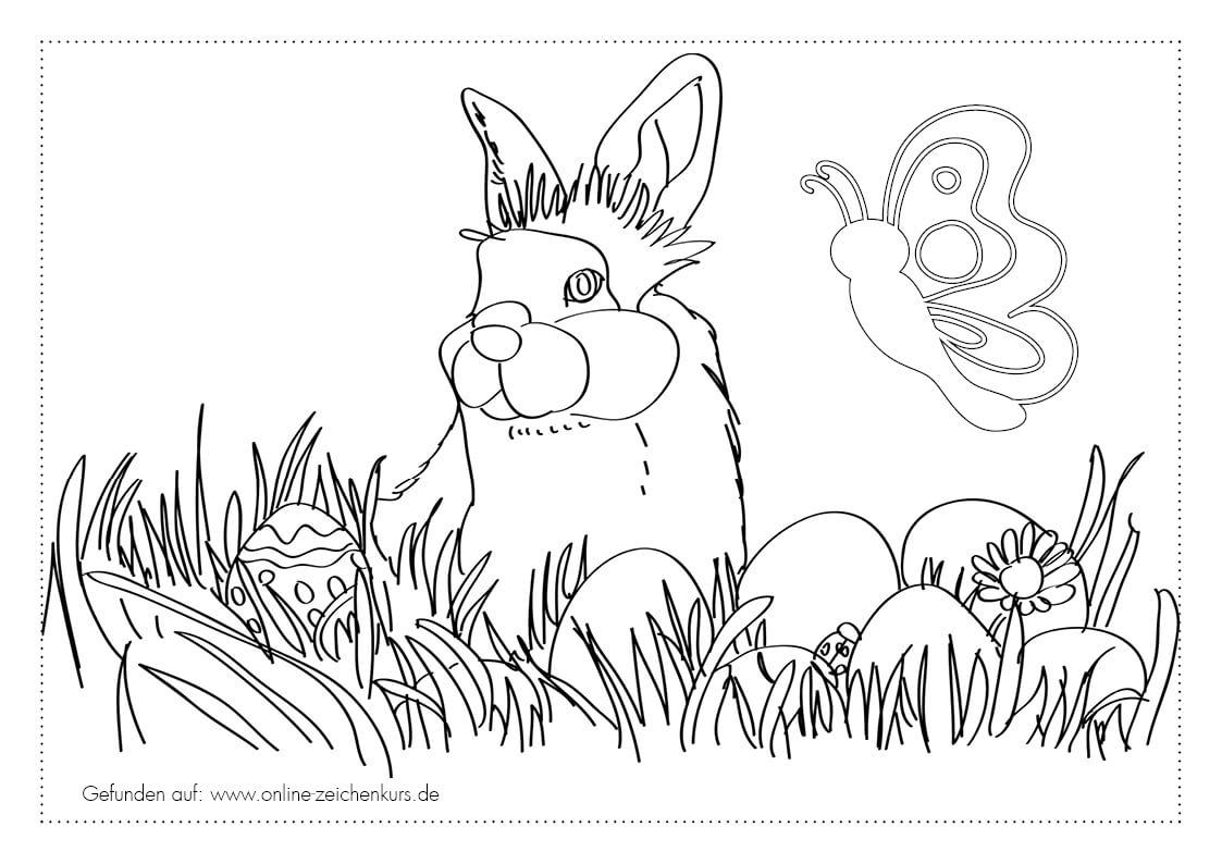 Kaninchen im Gras mit Ostereiern